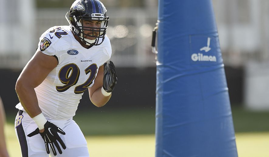 Baltimore Ravens defensive tackle Bronson Kaufusi runs a drill during NFL football training camp in Owings Mills, Md., Thursday, Aug. 4, 2016. Ravens rookie defensive end Bronson Kaufusi will miss the 2016 season after breaking his left ankle during practice Thursday. The injury occurred when another player fell on Kaufusi's leg during a non-live drill(AP Photo/Gail Burton)