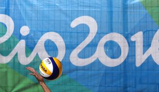 An athlete serves a ball during her training at the Copacabana beach volleyball arena prior the 2016 Summer Olympics in Rio de Janeiro, Brazil, Thursday, Aug. 4, 2016. (AP Photo/Petr David Josek)