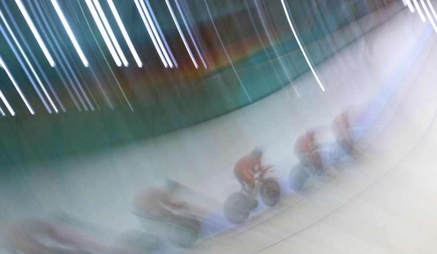 Members of the Chinese women's track cycling team round a turn during a training session inside the Rio Olympic Velodrome in advance of the 2016 Olympic Games in Rio de Janeiro, Brazil, Thursday, Aug. 4, 2016. (AP Photo/Patrick Semansky)
