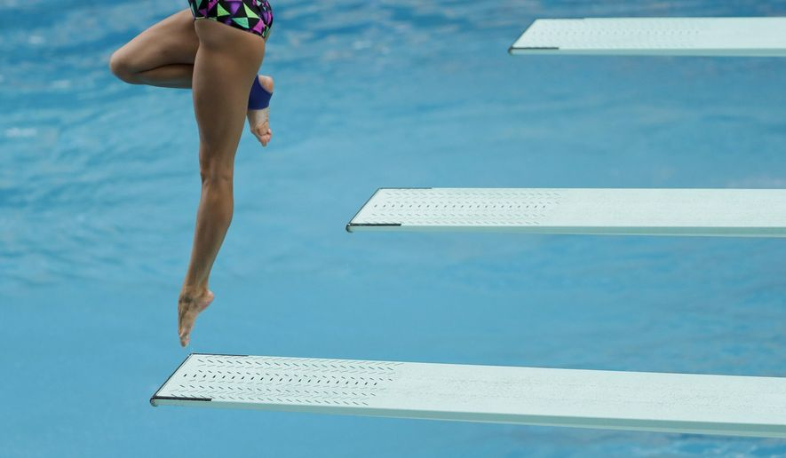 Russia diver Kristina Ilinykh practices during a training session at the Maria Lenk Aquatic Center ahead of the Summer Olympics in Rio de Janeiro, Brazil, Wednesday, Aug. 3, 2016. (AP Photo/Matt Slocum)