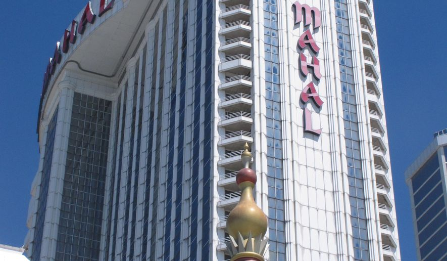 This Aug. 4, 2016 photo shows the exterior of the Trump Taj Mahal casino in Atlantic City, N.J a day after owner Carl Icahn said he will close the casino after Labor Day. (AP Photo/Wayne Parry)
