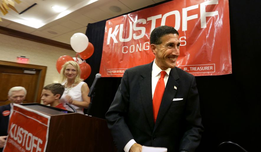 David Kustoff takes the stage with his family to thank his supporters as they celebrate his win for District 8 House of Representatives in Memphis, Tenn., Thursday, Aug. 4, 2016. (Nikki Boertman/The Commercial Appeal via AP)