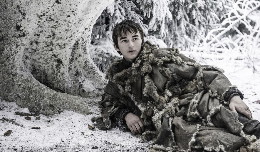 """This image released by HBO shows Isaac Hempstead, who plays Bran Stark, in a scene from """"Game of Thrones."""" A full orchestra will perform music from the popular series at the Hollywood Palladium on Monday and composer Ramin Djawadi will take questions alongside Wright. (HBO via AP)"""