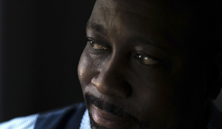 Air Force veteran Darryl Lewis poses for a portrait at his home, Thursday, Aug. 4, 2016, in Smyrna, Ga. Lewis filed a lawsuit in federal court in Washington saying he was illegally held and tortured by two top-ranking officials in Congo's government. (AP Photo/Branden Camp)