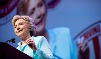 Democratic presidential candidate Hillary Clinton speaks at the 2016 National Association of Black Journalists' and National Association of Hispanic Journalists' Hall of Fame Luncheon at Marriott Wardman Park in Washington, Friday, Aug. 5, 2016. (AP Photo/Andrew Harnik)