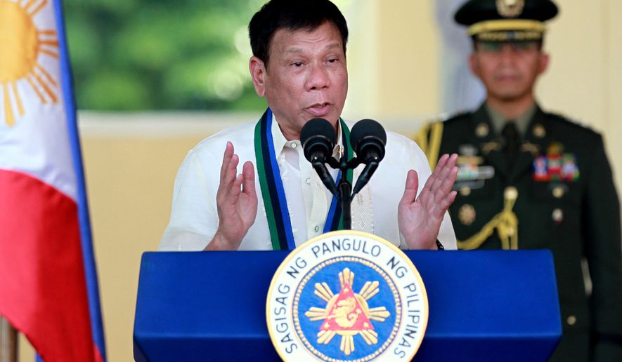 In this Friday, July 1, 2016, file photo, Philippine President Rodrigo Duterte addresses the troops during a military ceremony in suburban Quezon city northeast of Manila, Philippines. (AP Photo/Bullit Marquez, File)