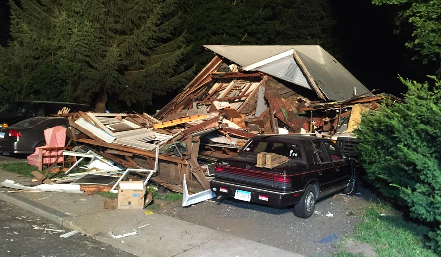 The front of a house that exploded is seen on East Street in Vernon, Conn, Thursday, Aug. 4, 2016. Connecticut authorities say an explosion has destroyed a house in the north-central part of the state, and officials say seven people, including a young child, have been taken to hospitals. The cause of the blast isn't known. (David Owens/Hartford Courant via AP)