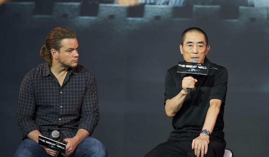 "FILE - In this July 2, 2015, file photo, movie director Zhang Yimou, right, speaks next to actor Matt Damon during a news conference of their latest movie ""The Great Wall"" held at a hotel in Beijing. Acclaimed Chinese director Zhang Yimou responded to criticism from an Asian-American actress over the casting of Matt Damon as his movie's lead, saying the role was never conceived for a Chinese actor. (AP Photo/Andy Wong, File)"