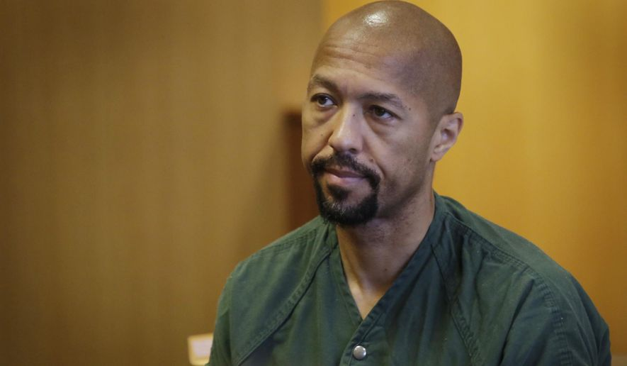 Ex-Detroit City Council president and former TV news anchor Charles Pugh returns to a courtroom during his preliminary trial Friday Aug. 5, 2016 at the Frank Murphy Hall of Justice in Detroit. (Mandi Wright/Detroit Free Press via AP)