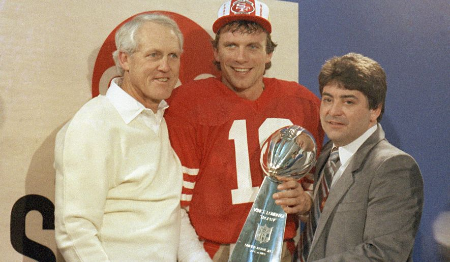 FILE - In this Jan. 20, 1985, file photo, San Francisco 49ers quarterback Joe Montana, center, holds the Lombardi Trophy with coach Bill Walsh, left, and 49ers owner Edward DeBartolo, Jr., in the locker room at Stanford, Calif. DeBartolo Jr. will be a Class of 2016 inductees into the Pro Football Hall of Fame in Canton, Ohio. (AP Photo, File)