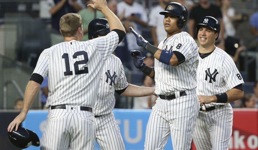 New York Yankees' Starlin Castro, second from right, is greeted by teammates Mark Teixeira, right, Chase Headley, left, and Brian McCann after hitting a grand slam during the third inning of the baseball game against the Cleveland Indians at Yankee Stadium, Friday, Aug. 5, 2016 in New York. (AP Photo/Seth Wenig)