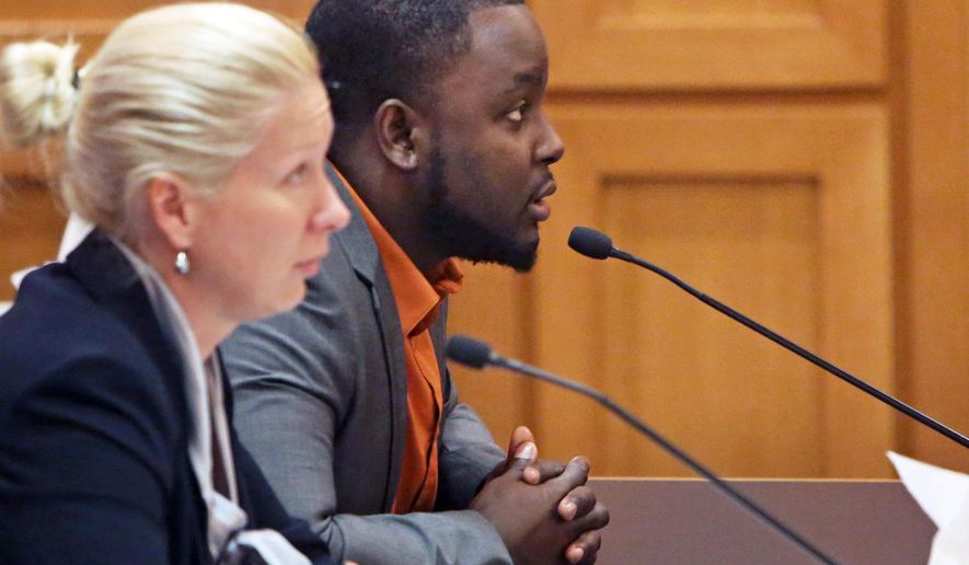 Former University of Wisconsin and NFL running back Montee Ball,right, with his attorney Erika Bierma, left, is sentenced on domestic abuse charges at the Dane County Courthouse in Madison, Wis., Friday, Aug. 5, 2016.  Ball was sentenced to 60 days in jail after pleading guilty to disorderly conduct and battery for his role in two domestic abuse incidents. (Amber Arnold/Wisconsin State Journal via AP)