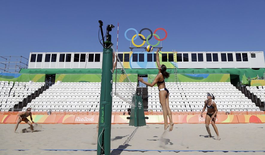 Competitors from Italy, at right, and Netherlands, play during a training session at the 2016 Summer Olympics in Rio de Janeiro, Brazil, Friday, Aug. 5, 2016. (AP Photo/Marcio Jose Sanchez)