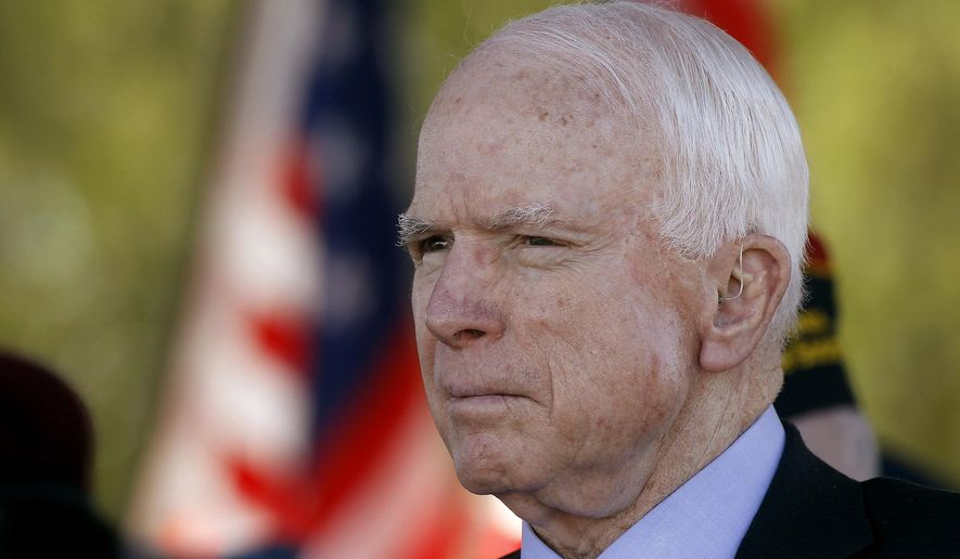 In this Monday, May 30, 2016, Sen. John McCain, R-Ariz, looks on during a Phoenix Memorial Day Ceremony at the National Memorial Cemetery of Arizona in Phoenix. (AP Photo/Ralph Freso, File)