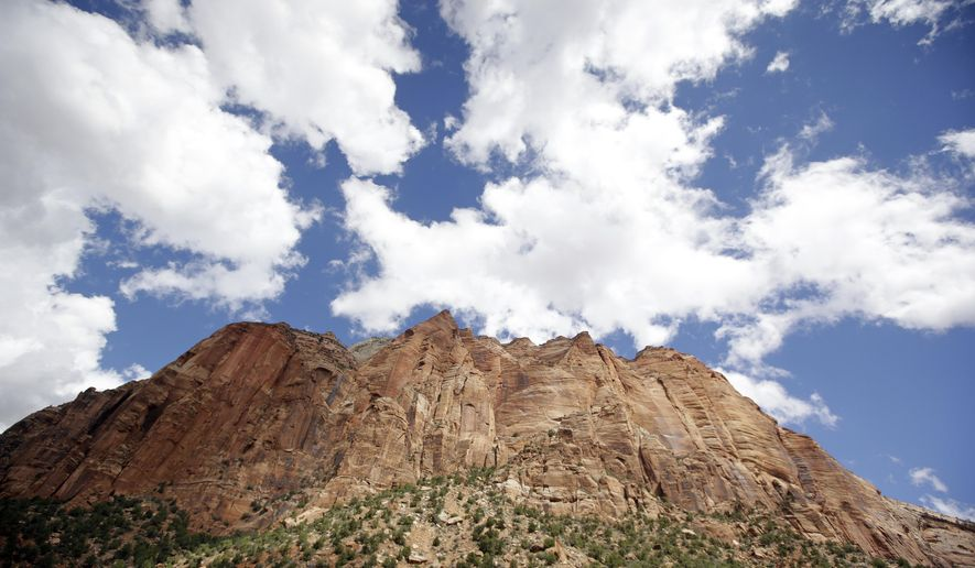 FILE - This Sept. 16, 2015, file photo, shows Zion National Park, near Springdale, Utah. Zion National Park officials say visitation has already grown by 11 percent this year and is on track to surpass 4 million visits. (AP Photo/Rick Bowmer, File)