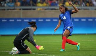 United States' goalkeeper Hope Solo, left, makes a save as France's Maire Laure Delie looks on during a group G match of the women's Olympic football tournament between United States and France at the Mineirao stadium in Belo Horizonte, Brazil, Saturday, Aug. 6, 2016. (AP Photo/Eugenio Savio)