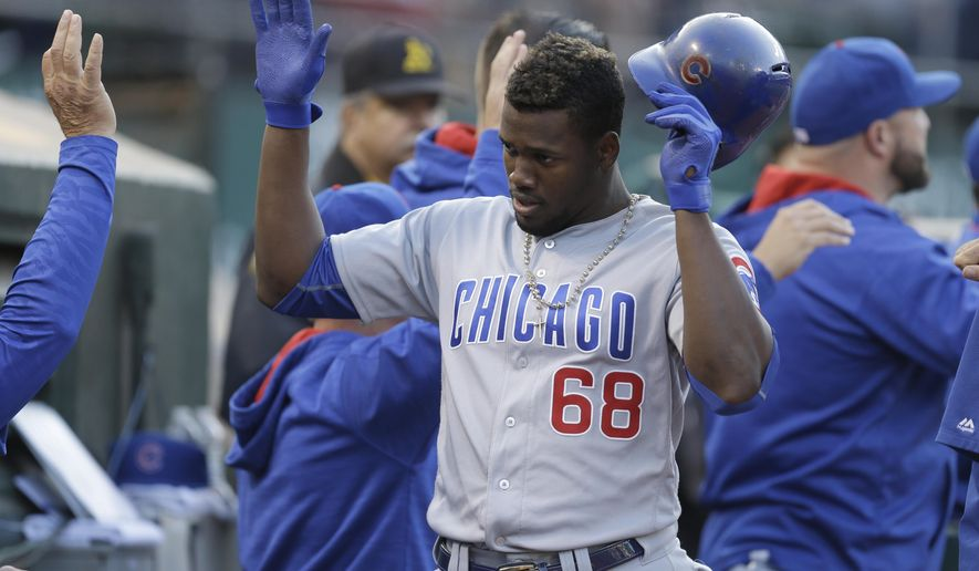 Chicago Cubs' Jorge Soler (68) celebrates after hitting a three-run home run off Oakland Athletics' Dillon Overton during the first inning of a baseball game Friday, Aug. 5, 2016, in Oakland, Calif. (AP Photo/Ben Margot)