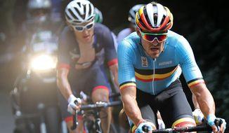 Belgium's Greg van Avermaet leads the peloton during the men's road race near Fort Copacabana at the Summer Olympics in Rio de Janeiro, Brazil, Saturday, Aug. 6, 2016.  (Bryn Lennon/Pool Photo via AP)