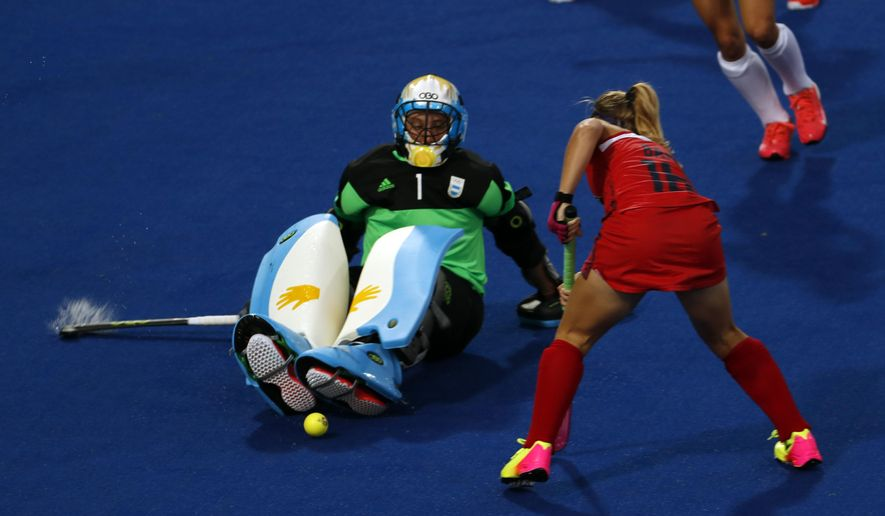 United States' Katie Bam tries to score as Argentina's goalkeeper Belem Succi defends during a women's field hockey match at the 2016 Summer Olympics in Rio de Janeiro, Brazil, Saturday, Aug. 6, 2016. (AP Photo/Dario Lopez-Mills)