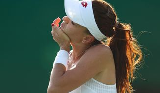 Agnieszka Radwanska of Poland stretches during the match against China's Saisai Zheng in the women's tennis competition at the 2016 Summer Olympics in Rio de Janeiro, Brazil, Saturday, Aug. 6, 2016. (AP Photo/Vadim Ghirda)
