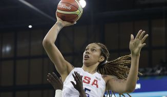 United States center Brittney Griner shoots over Senegal guard Fatou Dieng during the second half of a women's basketball game at the Youth Center at the 2016 Summer Olympics in Rio de Janeiro, Brazil, Sunday, Aug. 7, 2016. The United States defeated Senegal 121-56. (AP Photo/Carlos Osorio)