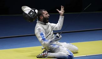 Andrea Avola, of Italy, celebrates after defeating Peter Joppich of Germany in the men's individual foil fencing event at the 2016 Summer Olympics in Rio de Janeiro, Brazil, Sunday, Aug. 7, 2016. (AP Photo/Andrew Medichini)