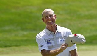 Jim Furyk celebrates after shooting a course and PGA-record 58 during the final round of the Travelers Championship golf tournament in Cromwell, Conn., Sunday, Aug. 7, 2016. (AP Photo/Fred Beckham)