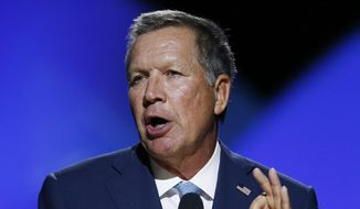 In a Sunday, July 17, 2016 file photo, Ohio Gov. John Kasich addresses the 2016 National Convention of the NAACP, in Cincinnati. Kasich says he has no idea how he'll vote come November because he doesn't support Donald Trump or Hillary Clinton. He also says he isn't sure whether Trump can win Ohio if he remains so divisive. (AP Photo/Gary Landers, File)