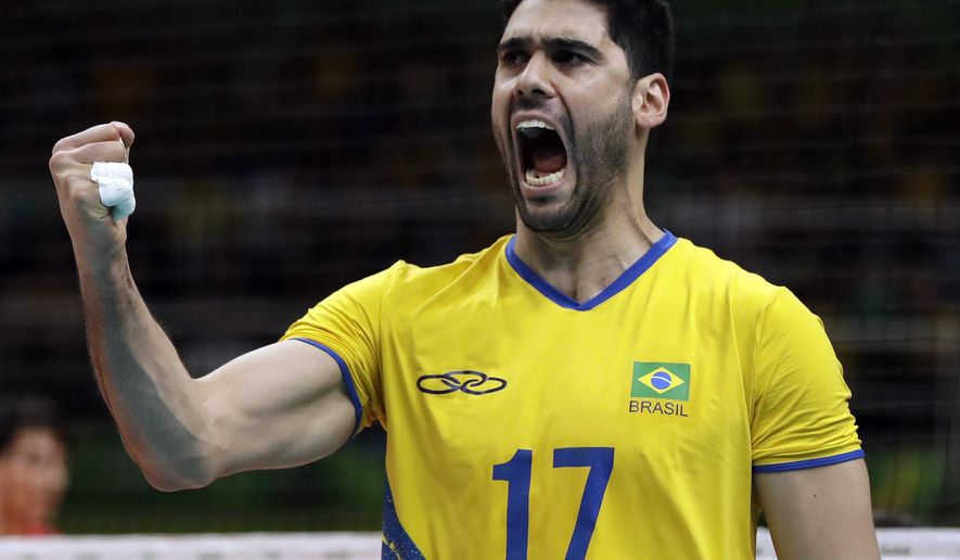 Brazil's Evandro M. Guerra celebrates during a men's preliminary volleyball match against Mexico at the 2016 Summer Olympics in Rio de Janeiro, Brazil, Sunday, Aug. 7, 2016. (AP Photo/Matt Rourke)