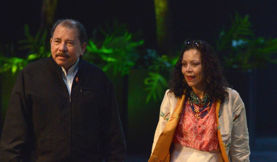 Nicaraguan President Daniel Ortega and his wife, Rosario Murillo, are accused by critics of running the Central American country as if it were their own and doing everything they can to cement family power. (Associated Press) ** FILE **