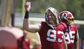 Washington Redskins outside linebacker Trent Murphy (93) reacts during practice at the team's NFL football training facility at Redskins Park, Wednesday, June 8, 2016 in Ashburn, Va. (AP Photo/Alex Brandon)