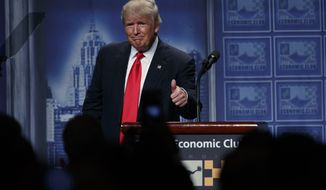 Republican presidential candidate Donald Trump gives a thumbs up after delivering an economic policy speech to the Detroit Economic Club, Monday, Aug. 8, 2016, in Detroit. (AP Photo/Evan Vucci)