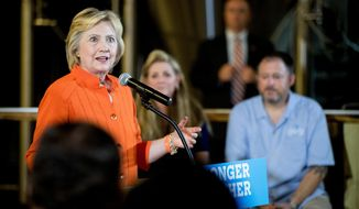 Democratic presidential candidate Hillary Clinton speaks after touring 3 Daughters Brewery, in St. Petersburg, Fla., Monday, Aug. 8, 2016. (AP Photo/Andrew Harnik)