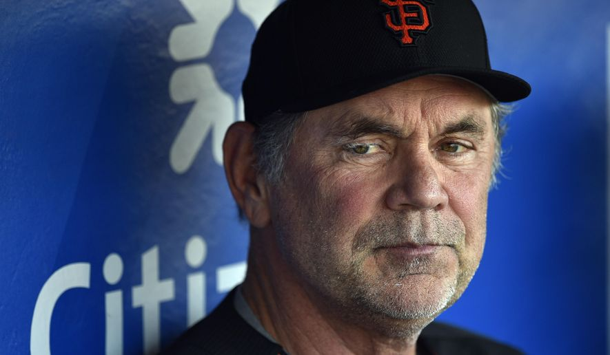 This Aug. 2, 2016 photo shows San Francisco Giants manager Bruce Bochy in the dugout prior to a baseball game against the Philadelphia Phillies in Philadelphia. Bochy has been admitted to a Miami hospital after falling ill and will miss the game against the Marlins on Monday, Aug. 8, 2016. (AP Photo/Derik Hamilton)