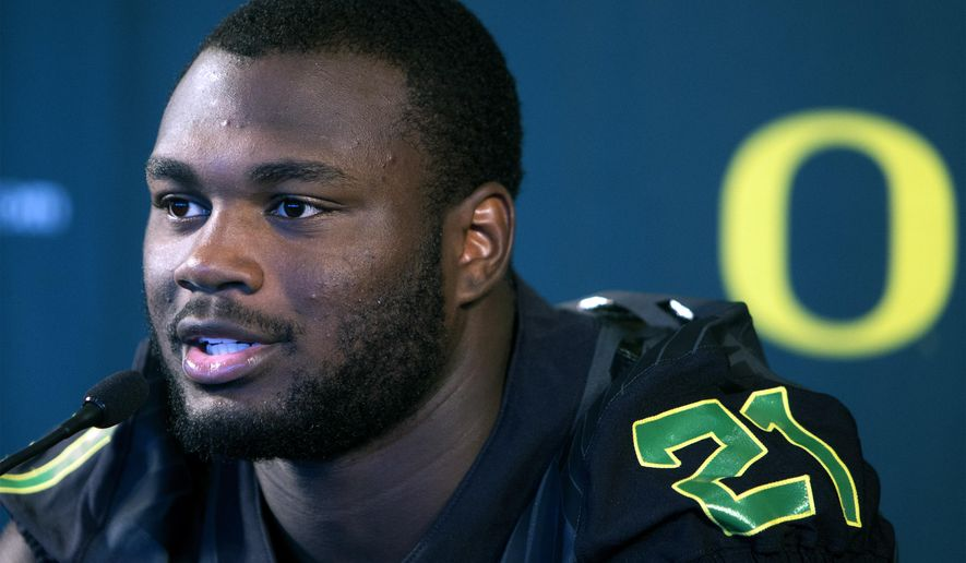 Oregon running back Royce Freeman answers questions from members of the media during Oregon NCAA football media day at Autzen Stadium in Eugene, Ore., Monday, Aug. 8, 2016. Freeman has been mentioned as a Heisman Trophy prospect after having two strong seasons with the Ducks. (Andy Nelson/The Register-Guard via AP)