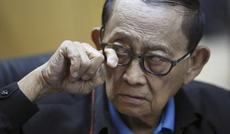 Former Philippine President Fidel Ramos pokes his eyewear to show reporters that it doesn't have any glass during a press conference before his flight at Manila's International Airport in suburban Pasay, south of Manila, Philippines, Monday, Aug. 8, 2016. Ramos flew to Hong Kong on Monday for talks with long-standing contacts after being asked by current President Rodrigo Duterte to travel to China and start discussions on the South China Sea. (AP Photo/Aaron Favila)