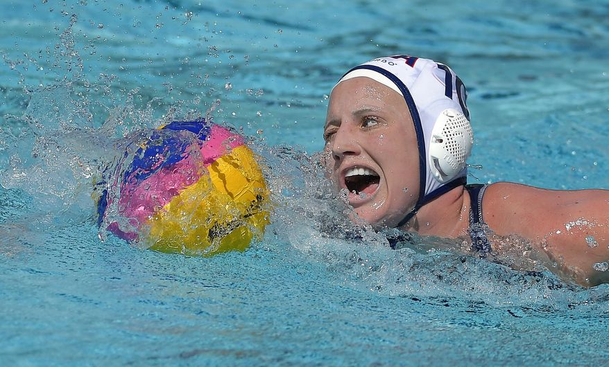 FILE - In this May 22, 2016, file photo, United States attacker Kaleigh Gilchrist moves the ball during a women's exhibition water polo match against Australia, in Los Angeles. Gilchrist is all about water polo right now. When surfing joins the Olympics in 2020, well, check back with her closer to Tokyo. Gilchrist is a steady attacker for the U.S. women's water polo team, favored to win a second straight gold medal in Rio de Janeiro. But she plans to try for a pro surfing career after the Olympics. (AP Photo/Mark J. Terrill, File)