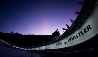 FILE - In this Dec. 7, 2013 file photo, Natalia Wojtusciszyn, of Poland, races down the track during the women's World Cup luge in Whistler, British Columbia. Vail Resorts, which is the largest resort operator in North America, is buying the continent's biggest ski area, Canada's Whistler, the site of the 2010 Winter Olympics. Vail Resorts Inc. announced Monday, Aug. 8, 2016, that it was purchasing Whistler Blackcomb Holdings Inc., the Canadian ski resort company, for $1.06 billion, adding to its aggressive expansion. (Darryl Dyck/The Canadian Press via AP)