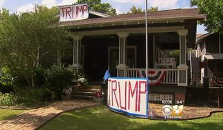 """Kimberly Loyd's McKinney home dubbed the """"Trump House"""" has been repeatedly targeted by vandals and protesters because of its large banners and signs declaring support for the Republican presidential nominee. (CBSDFW)"""