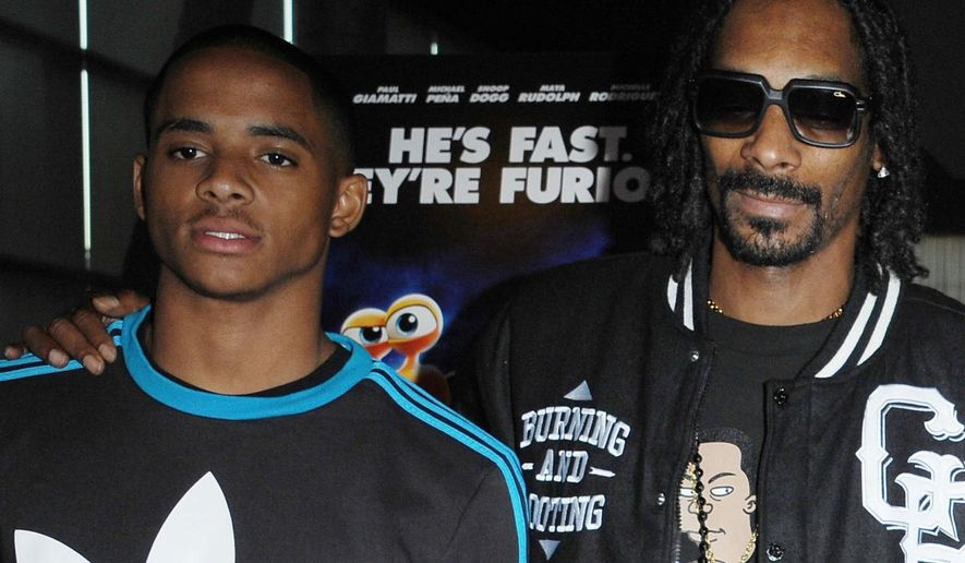 """FILE - In this July 16, 2013 file photo, Snoop Dogg, right, poses with his son, Cordell Broadus, at the Snoop Youth Football League's special screening of """"Turbo"""" at the ArcLight Hollywood in Los Angeles. Cordell Broadus, UCLA wide receiver, has left the program for a second time, coach Jim Mora said Monday, Aug. 8, 2016. (Photo by Katy Winn/Invision/AP)"""