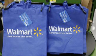 Reusable shopping bags are offered for sale at a Wal-Mart Neighborhood Market in the Chinatown district of Los Angeles on Sept. 19, 2013. (Associated Press) **FILE**