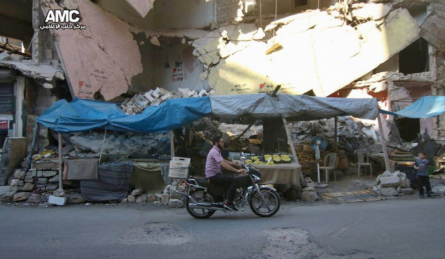 Residents trapped in rebel-controlled Aleppo, Syria, struggle to survive in their once-thriving city as bread and medication become scarce. (Aleppo Media Center via Associated Press)