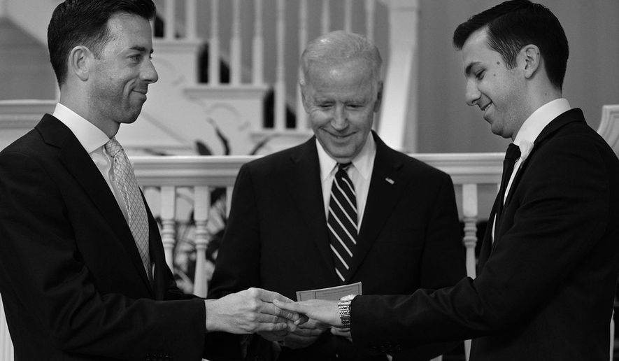 """Vice President Joe Biden tweeted this photo of the wedding: """"Proud to marry Brian and Joe at my house. Couldn't be happier, two longtime White House staffers, two great guys."""""""