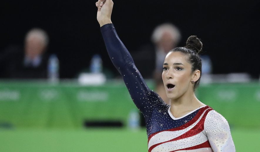 United States' Aly Raisman celebrates after her performance on the floor during the artistic gymnastics women's team final at the 2016 Summer Olympics in Rio de Janeiro, Brazil, Tuesday, Aug. 9, 2016. (AP Photo/Charlie Riedel)