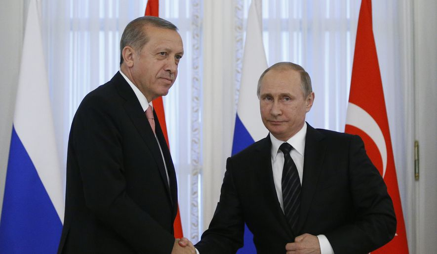Russian President Vladimir Putin, right, and Turkish President Recep Tayyip Erdogan shake hands at a news conference after their talks in the Konstantin palace outside St.Petersburg, Russia, on Tuesday, Aug. 9, 2016. President Erdogan travels to Russia to meet with President Putin for the first time since apologizing in late June for the downing of a Russian fighter jet along the Syrian border in November last year. (AP Photo/Alexander Zemlianichenko)