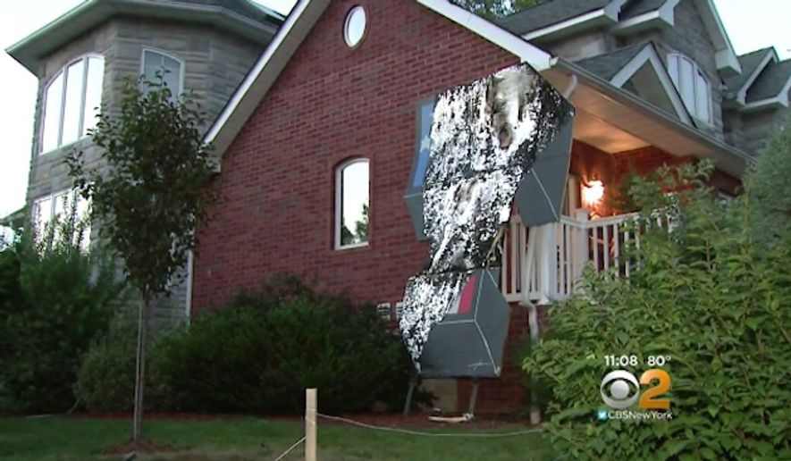 Sam Pirozzolo, of New York City, said Donald Trump called him personally after his 12-foot tribute to the Republican presidential nominee was set ablaze in his front yard over the weekend. (CBS New York)