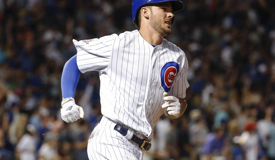 Chicago Cubs' Kris Bryant runs the bases on a solo home run off Los Angeles Angels' Jered Weaver during the fifth inning of a baseball game Tuesday, Aug. 9, 2016, at Wrigley Field in Chicago. (AP Photo/Kamil Krzaczynski)