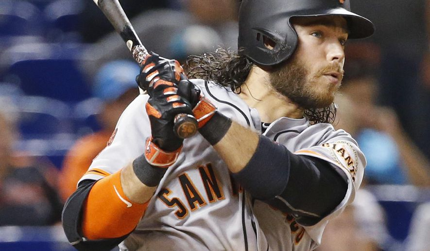 San Francisco Giants' Brandon Crawford watches the ball as he hits a triple during the 13th inning of a baseball game against the Miami Marlins, Monday, Aug. 8, 2016, in Miami. The Giants defeated the Marlins 8-7 early Tuesday, in 14 innings. Crawford became the first major league player in 41 years to get seven hits in a game. (AP Photo/Wilfredo Lee)