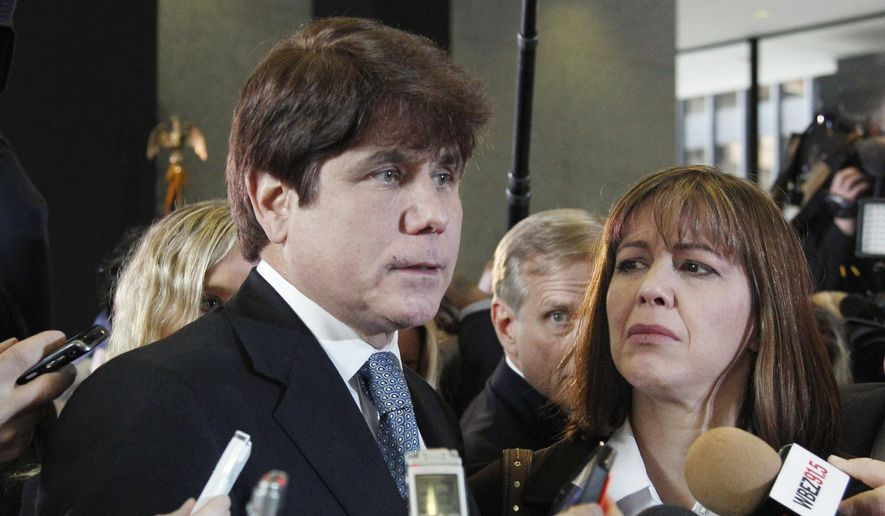In this Dec. 7, 2011, file photo, former Illinois Gov. Rod Blagojevich, left, speaks to reporters as his wife, Patti, listens at the federal building in Chicago. A federal judge will decide Tuesday, Aug. 9, 2016, whether to cut the 14-year prison term given to Blagojevich after he was convicted of corruption, including charges that he tried to exchange an appointment to President Barack Obama's old U.S. Senate seat in exchange for campaign donations. (AP Photo/M. Spencer Green, File)