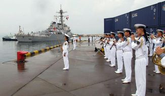 In this Monday, Aug. 8, 2016, file photo, a Chinese military band plays as the guided missile destroyer USS Benfold arrives in port in Qingdao in eastern China's Shandong Province. The visit of the U.S. Navy's USS Benfold to the northern Chinese port of Qingdao this week is the latest development in a long-term effort to build trust between the countries' militaries amid tensions and a rivalry for dominance in Asia. (AP Photo/Borg Wong, File)